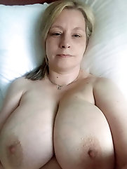 Aged female is playing with her tits